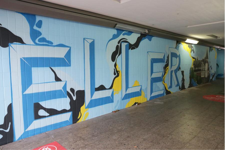 Neben zahlreichen lokalen Motiven wurde die Unterführung mit bunten Farben hell und freundlich gestaltet (Foto: Stadt Düsseldorf/Ingo Lammert)
