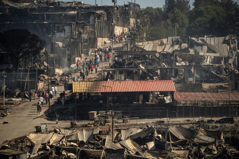 Forderungen nach Aufnahme von mehr Geflüchteten nach Großbrand in Moria (© 2020 AFP)