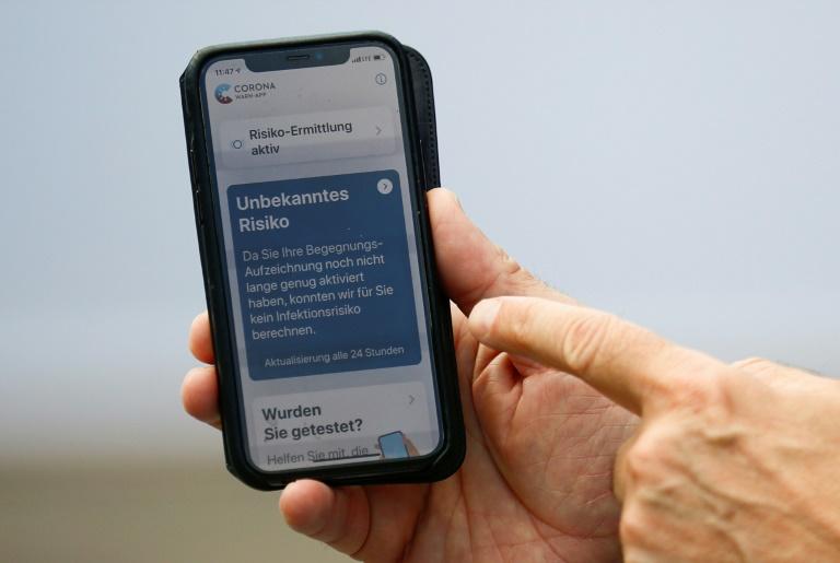 Positive Corona-Tests werden immer häufige per App geteilt (© 2020 AFP)