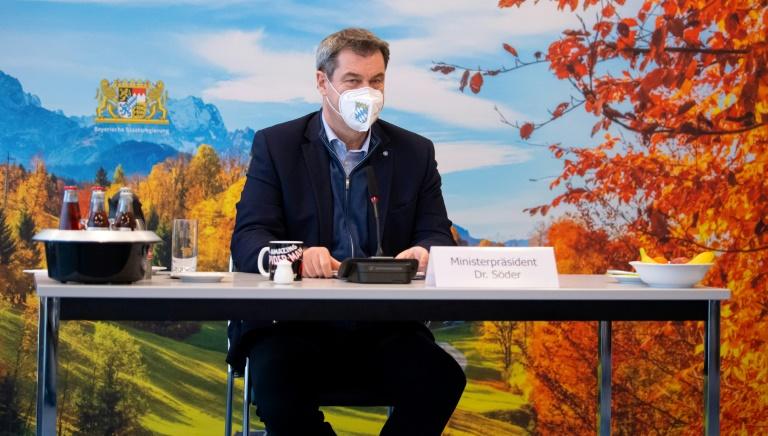 Bayern macht Tragen von FFP2-Masken in ÖPNV und Geschäften verpflichtend (© 2021 AFP)