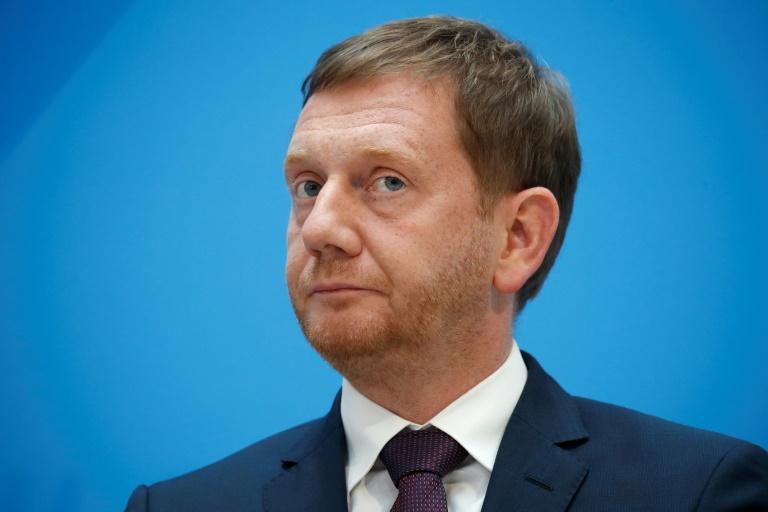Ministerpräsident Kretschmer stellt Bundesnotbremse in Frage (© 2021 AFP)
