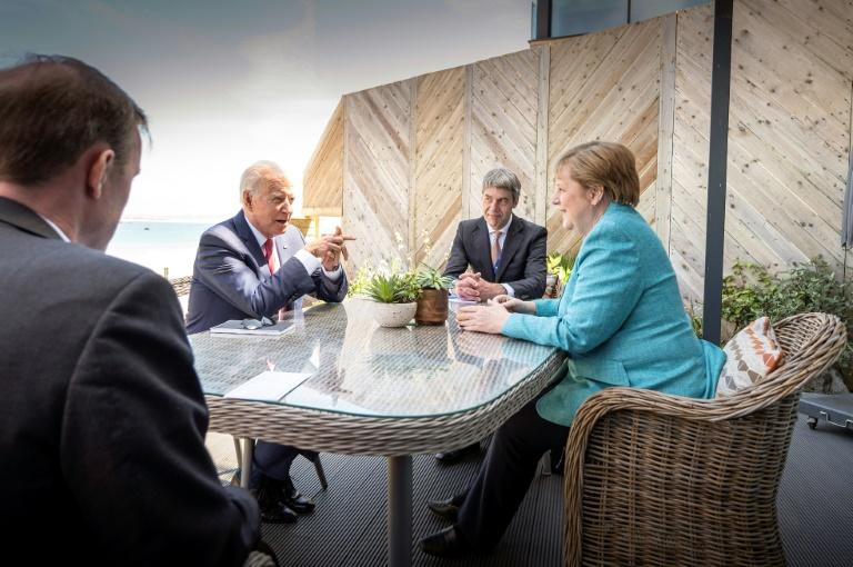 Biden will Merkel mit offiziellem Abendessen im Weißen Haus würdigen (© 2021 AFP)