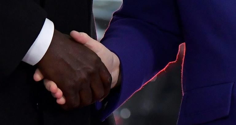 "Merkel begrüßt zu Konferenz der Initiative ""Compact with Africa"" (© 2021 AFP)"